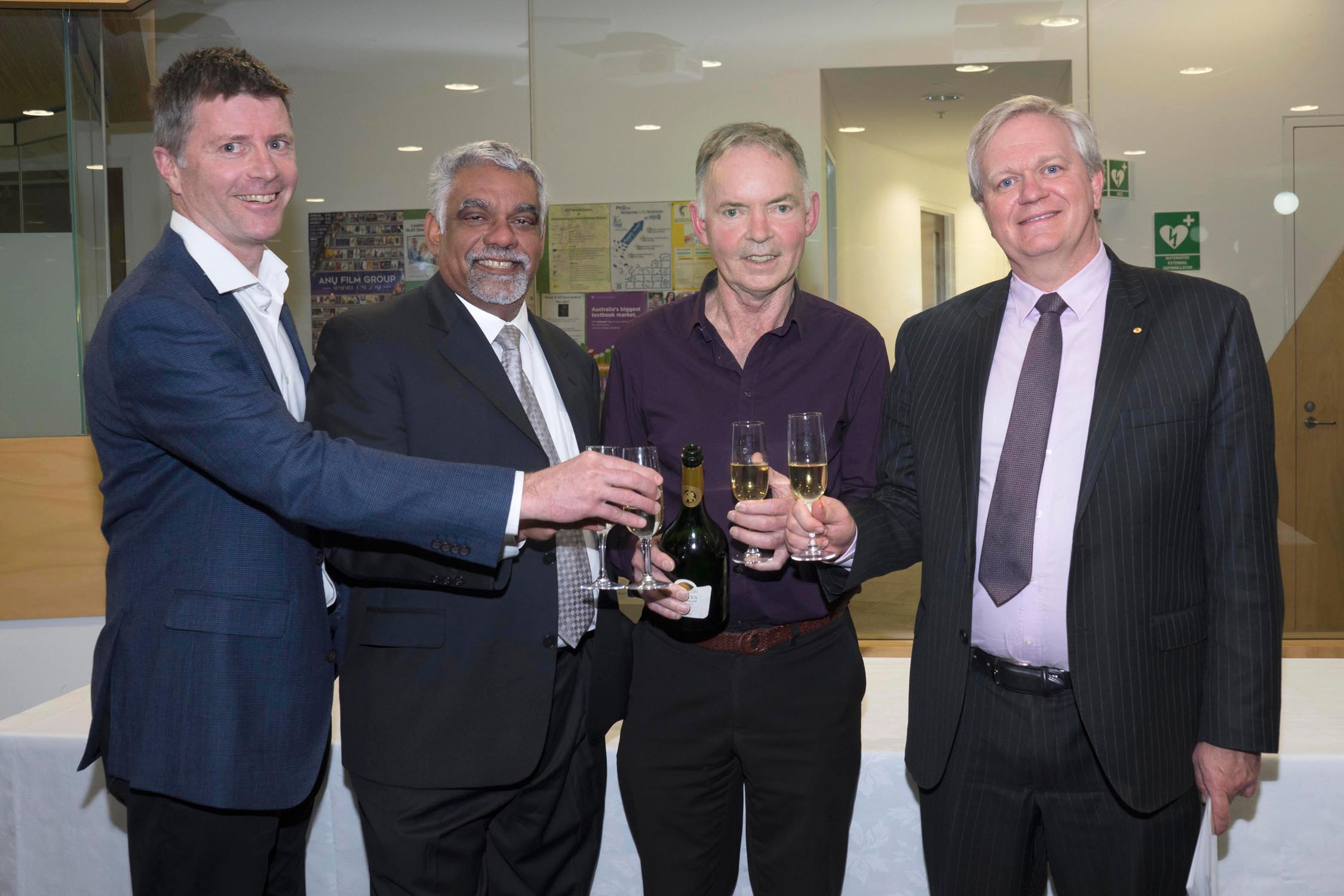 Professor Owen Atkin, RSB Director Allen Rodrigo, Professor Graham Farquhar, and ANU Vice-Chancellor Professor Brian Schmidt toast Graham's achievement
