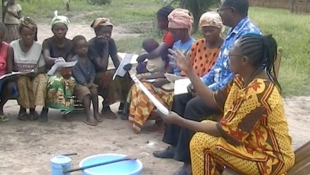 Women leaning how remove the poisonous cyanide compound from cassava flour